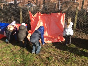 The children used pegs and logs to build their tents with tarpaulin.